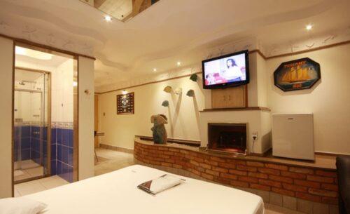 img-suite-luxo-c-garagem-ambiente-absolut-motel