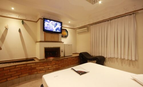 img-suite-luxo-c-garagem-tv-absolut-motel
